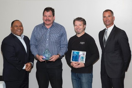 On the left – Brian Jarvis, Vice-President Claims, ICBC Left Centre Charles Taylor Taylormotive General Manager Right Center Michael Mooney Taylormotive Collision Manager,  On the right – Scott Kozak, Senior Vice-President, Sales & Service, Mitchell International